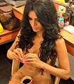 Sherlyn Chopra covers her nudity with a cup of coffee