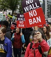 In this May 15, 2017 file photo, protesters wave signs and chant during a demonstration against President Donald Trump's revised travel ban