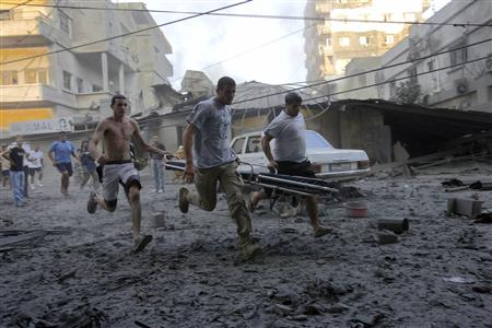 Lebanese men run to help survivors after an Israeli bomb destroyed two six-storey high buildings in Tyre, July 26, 2006. REUTERS/Nikola Solic. Suggestion: Avoid living near Hezbolla missile launching sites