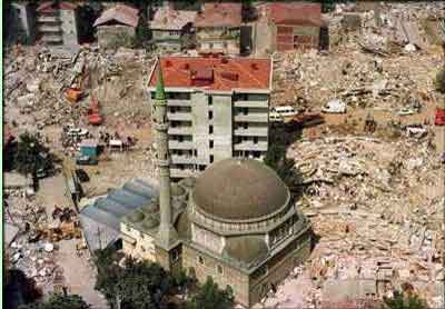 A mosque stood with a few other structures amid the rubble of collapsed buildings in the town of Golcuk, 60 miles east of Instanbul