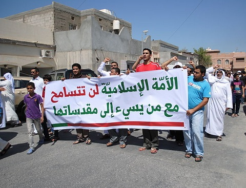 A protest in Duraz, Bahrain against an anti-Islamic film. The banner (in Arabic) reads: 'The Islamic nation will not tolerate with those who offend its sanctities'