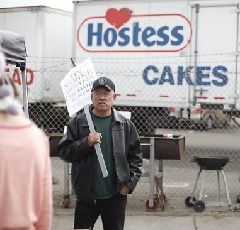 Jose Lopez, a 24 year Hostess machine operator, strikes in front of the Columbo Bread factory operated by Hostess on Nov. 16, 2012 in Oakland, Calif