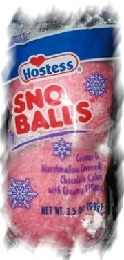 Sno Balls are cream-filled chocolate cakes, which are then covered with marshmallow frosting and coconut flakes.