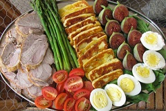 salmagundi - A dish composed of chopped meat, anchovies, eggs, onions with oil and condiments
