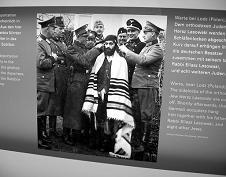 nazi officers shearing Jew's hair