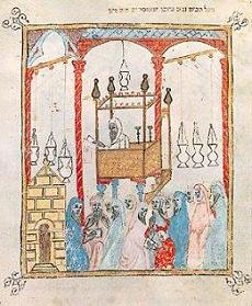 Image of a cantor reading the Passover story in Moorish Spain, from a 14th century Spanish Haggadah.
