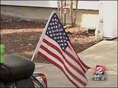 Residents of the Oaks Apartments in Albany have reportedly been told to take down their flags.