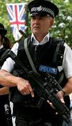 Officers of the Ministry of Defence Police in the UK on foot patrol in the Whitehall area.