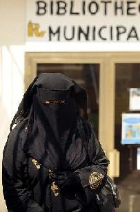 A woman wears a burka in Roncin, northern France. The proposed legislation to ban the veil in public would protect the 'dignity' of women