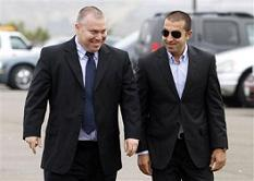 Mosab Hassan Yousef, right, walks into his deportation hearing with former Israeli security service agent Gonen Ben-Itzhak, left, at the immigration detention center in San Diego Wednesday, June 30, 2010.