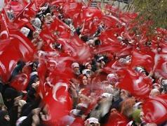 People wave Turkish flags during an anti-Pope rally organised by the Islam-based Welfare Party in Istanbul November 26, 2006. Pope Benedict XVI is expected to arrive in Turkey on Tuesday. (Pawel Kopczynski/Reuters)