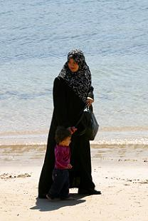 hijab Muslim woman with child at beach