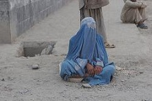 Burqa clad woman resting in Kabul