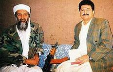 Osama bin Laden with journalist Hamid Mir during the interview for a Pakistani newspaper