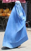 Blue burqa'd woman flying through the streets of Afghanistan.