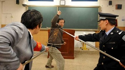 Chinese policemen show teachers and school workers how to defend themselves during an attack, at a school