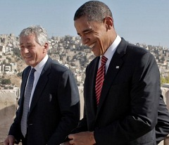Sen. Chuck Hagel, R-Neb., walks with Barack Obama as they tour the citadel in Amman, Jordan, in July 2008.