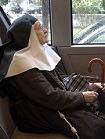 nun on a bus