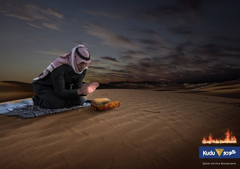 Arab advertising is often unafraid to play to stereotypes. Here, a keffiyeh-wearing desert nomad warms his hands at night over a spicy chicken sandwich from Kudu, a chain restaurant.