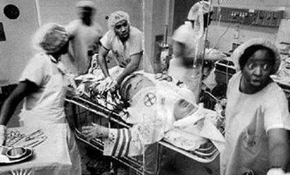 KKK in black operating room