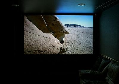 Projection screen in a home theater, displaying an HD-TV image.