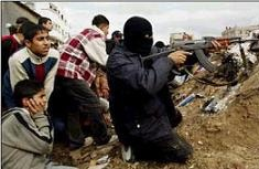 Arab terrorist  firing from the middle of a group of kids