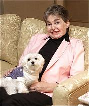 Leona Helmsley and her dog Trouble photographed in Leona Helmsley's Park Lane Hotel apartment. Helmsley left her beloved white Maltese, named Trouble, a $12 million trust fund. (AP file)