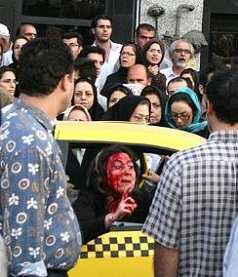 Iranian woman beaten for not wearing veil