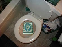 koran in toilet