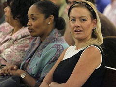 O.J. Simpson's daughter, Arnelle Simpson, center, and his girlfriend Christine Prody, right, sit together in a Clark County Justice courtroom during Simpson's arraignment in Las Vegas, Wednesday, Sept. 19, 2007.