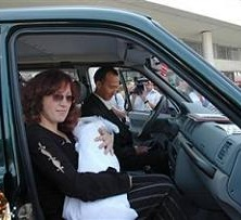 The Kartuzov family, shown in June 2007, drive away in their new UAZ-Patriot SUV, which they won as a grand prize in a regional contest titled: Give Birth to a Patriot on Russia's Independence Day.