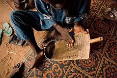 Koran verses get washed down from the wooden board to be drunk by marabout's patients