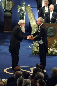 Robert J. Aumann receiving his Prize from His Majesty the King Carl XVI Gustaf of Sweden at the Stockholm Concert Hall, December 10, 2005.