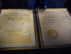 Two Nobel Prize certificates on display at the Nobel Museum in Stockholm, Sweden