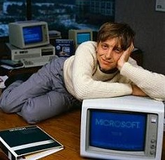 Bill Gates, CEO of Microsoft, reclines on his desk in his office soon after the release of Windows 1.0. 1985 Bellevue, Washington, USA