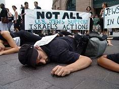 Inviting the wrath of their co-religionists, young American Jews stage a die-in in front of the Boston train station.