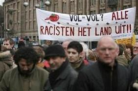 Demonstrators hold banners during a protest against Dutch politician and anti-Islam filmmaker Geert Wilders on Dam square in Amsterdam, March 22, 2008.
