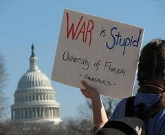 War is Stupid sign and US Capitol building at United for Peace rally and march on Washington, DC