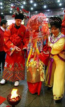 a traditional Chinese wedding ceremony held in Yu Garden, a famous Chinese garden in Shanghai.