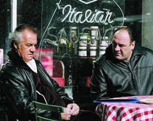Paulie and Tony sitting outside Satriale's