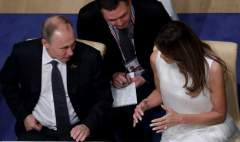 American first lady Melania Trump and Russian president Putin sitting at dinner at the G20 Summit in Germany.