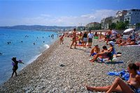 Photo credit http://www.alpix.com/nice/htmlfr/pict3.htm topless beach nice france