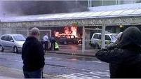 A vehicle burned on Saturday after it hit a section of Glasgow Airport