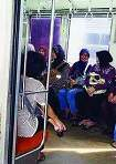 Indonesian women aboard a women-only carriage of a commuter train near Jakarta allocated strictly for female passengers and their children.