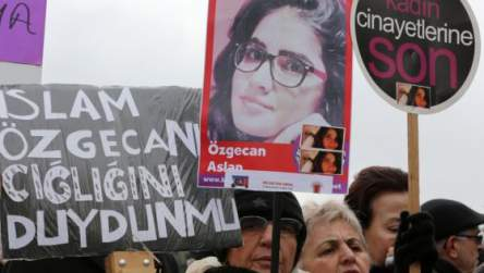 A Turkish woman holds a poster of murdered 20-year-old student Ozgecan Aslan at a protest in Ankara Feb. 18, 2015. The placards read: 'End the killings of women' and 'Islam (Aysenur Islam, Family Affiars minister), did you hear Ozgecan's scream?'